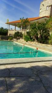 The swimming pool at or near Torre de Pineda