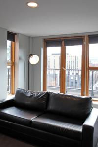 A seating area at The City Warehouse Aparthotel