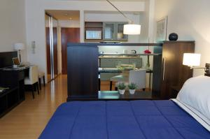 A kitchen or kitchenette at Concord Callao by Temporary Apartments