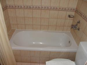 A bathroom at Club Amaris Apartment