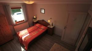 Łóżko lub łóżka w pokoju w obiekcie Apartamenty Szklarska