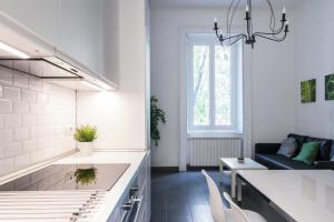 A kitchen or kitchenette at Bergognone Apartment