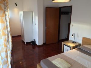 A television and/or entertainment centre at São Brás Apartment