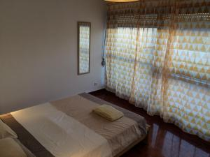 A bed or beds in a room at São Brás Apartment