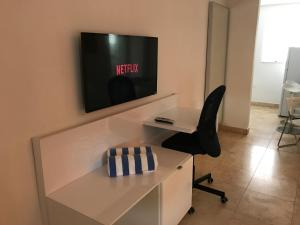 A television and/or entertainment centre at Wave Beach Vacation Rentals