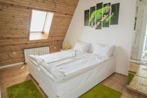 A bed or beds in a room at Sofia Esenss Two-Level Apartment