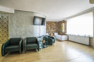 A seating area at Sofia Esenss Two-Level Apartment