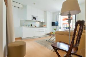 A kitchen or kitchenette at Acetres 1B Sevilla Center