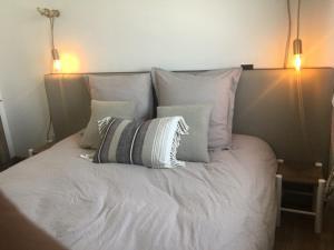 Un ou plusieurs lits dans un hébergement de l'établissement Le Wim'heureux Plage