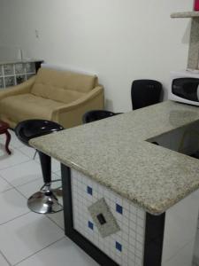 A seating area at Flat Avenida Oceânica Barra