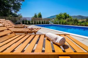 The swimming pool at or near Holiday Home Gata 7
