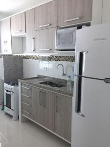 A kitchen or kitchenette at Praia Grande