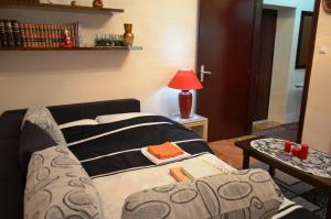 A bed or beds in a room at Apartment Center
