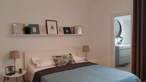 A bed or beds in a room at Panorama Studios Old City Center 38