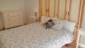 A bed or beds in a room at Apartamento Juan XXIII Plaza