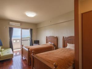 海人の宿にあるベッド