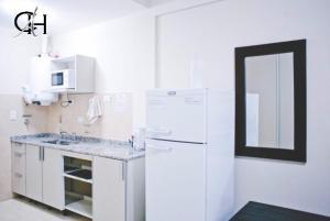 Una cocina o kitchenette en Apart Catamarca Chacabuco