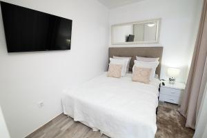 Łóżko lub łóżka w pokoju w obiekcie Ocean View Apartments