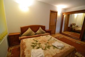 Un ou plusieurs lits dans un hébergement de l'établissement Vila Ioana