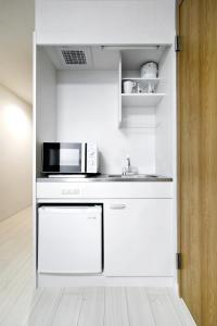 A kitchen or kitchenette at Osaka City Hotel
