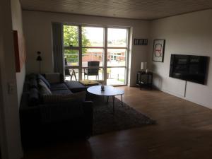 Een zitgedeelte bij Lovely House in Vejle