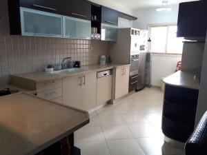 A kitchen or kitchenette at keren apartment