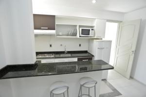 A kitchen or kitchenette at Apart Hotel Bhally INN