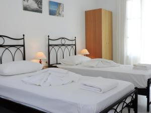 Ένα ή περισσότερα κρεβάτια σε δωμάτιο στο Elichryson Studios