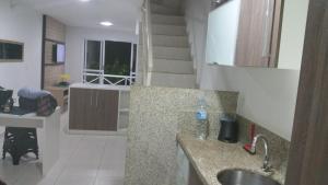 A kitchen or kitchenette at Condominio Angra Green Coast