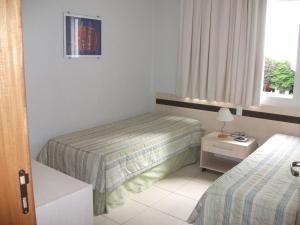 A bed or beds in a room at RQ TURISMO - HOTEL AGUAS DA SERRA