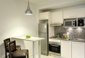 A kitchen or kitchenette at Piccaluga Apartments