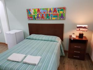 A bed or beds in a room at Jucati Season Apartments