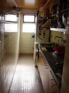 Una cocina o kitchenette en Departamento familiar por temporada