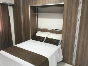 A bed or beds in a room at Apart Hotel Rio Stay