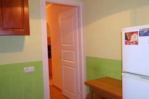 Кухня или мини-кухня в Апартаменты Северная Столица