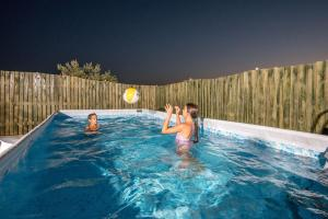 The swimming pool at or near Golan Heights Chalets