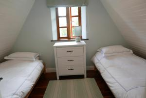 A bed or beds in a room at Stunning cottage near Kinvara