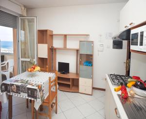 A kitchen or kitchenette at Residence Maryel