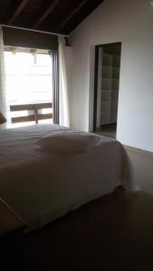 A bed or beds in a room at Casa Na beira Mar em Torres