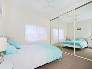 A bed or beds in a room at Silver Sands Serenity