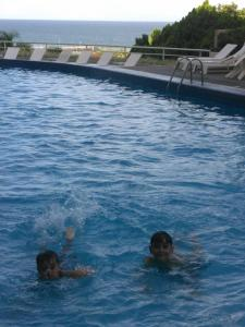 The swimming pool at or near Airport/BleuSuite