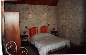 Un ou plusieurs lits dans un hébergement de l'établissement Gîte Le Val Fleuri