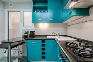 A kitchen or kitchenette at Elegant 3bed with views of Sagrada Familia