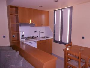 A kitchen or kitchenette at Golden Sand Suites