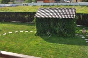 A garden outside Arneevo Apart&Hotel
