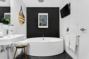A bathroom at North Adelaide Boutique Stays Accommodation