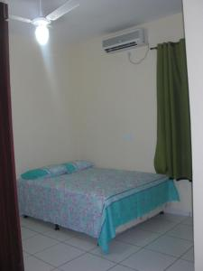A bed or beds in a room at Bonito Residencial Flat