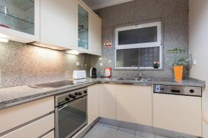 A kitchen or kitchenette at Charming Apartment in Braga Historical Center - Minho's Guest