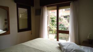 A bed or beds in a room at Casa em Torres
