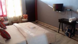 Letto o letti in una camera di High View Cottage - Rishikesh